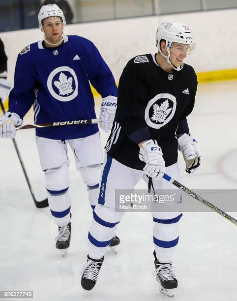 Travis Dermott and Connor Brown of the Toronto Maple Leafs skate during practice a day before their outdoor NHL Stadium Series Game against the...