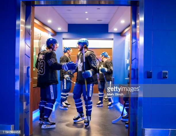 Travis Dermott and Timothy Liljegren of the Toronto Maple Leafs wears a jersey honouring the Canadian Armed Forces before warmup before facing the...