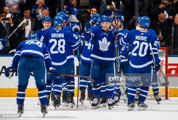 Travis Dermott Dominic Moore and Connor Brown of the Toronto Maple Leafs celebrate defeating the Anaheim Ducks during the second period at the Air...
