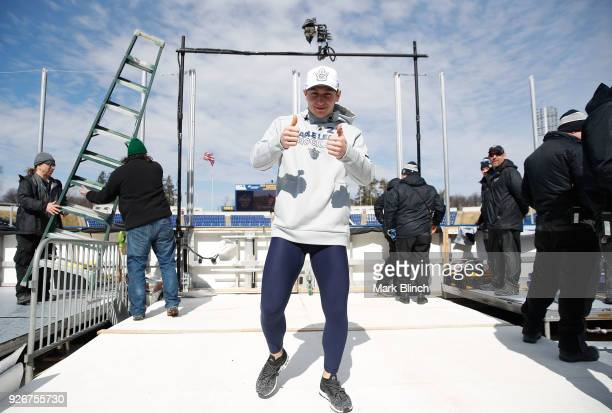 Travis Dermott of the Toronto Maple Leafs gives the thumbs up after checking the ice surface prior to the Coors Light NHL Stadium Series game between...