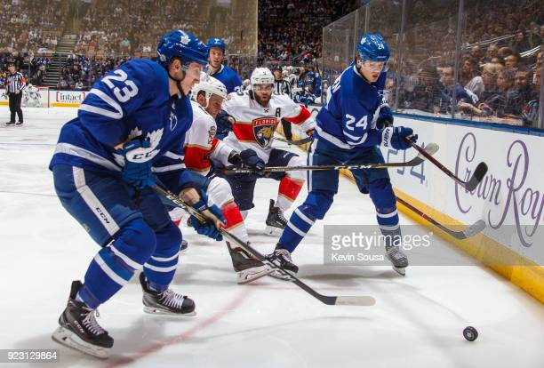 Travis Dermott of the Toronto Maple Leafs Kasperi Kapanen and Aaron Ekblad of the Florida Panthers surround the puck during the third period at the...