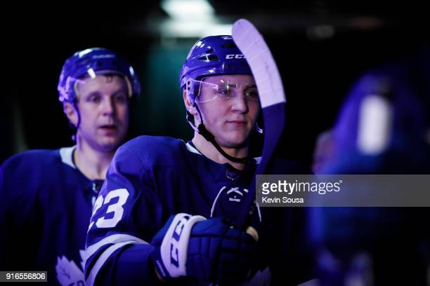 Travis Dermott of the Toronto Maple Leafs returns to the dressing room to face after the first period at the Air Canada Centre on February 7 2018 in...