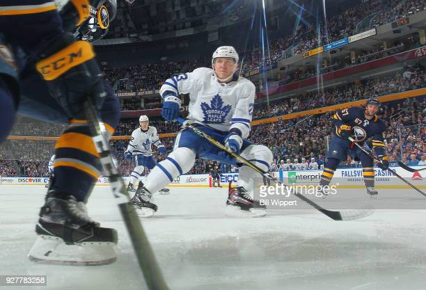 Travis Dermott of the Toronto Maple Leafs skates against the Buffalo Sabres during an NHL game on March 5 2018 at KeyBank Center in Buffalo New York
