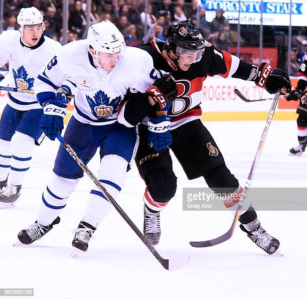 Travis Dermott of the Toronto Marlies battles with Gabriel Gagne of the Belleville Senators during AHL game action on November 25 2017 at Air Canada...