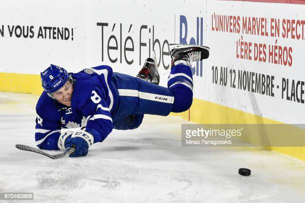 Travis Dermott of the Toronto Marlies falls as he skates the puck against the Laval Rocket during the AHL game at Place Bell on November 1 2017 in...