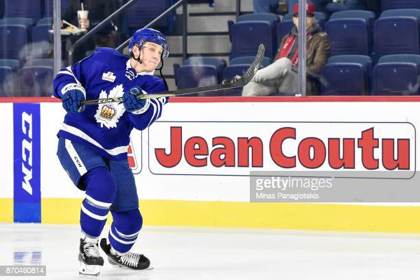 Travis Dermott of the Toronto Marlies takes a shot during the warmup prior to the AHL game against the Laval Rocket at Place Bell on November 1 2017...