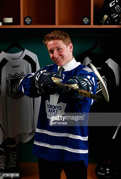 Travis Dermott poses for a portrait after being selected 34th by the Toronto Maple Leafs during the 2015 NHL Draft at BBT Center on June 27 2015 in...