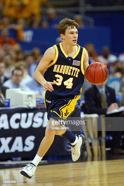 Travis Diener of Marquette University Golden Eagles advances the ball during the semifinal round of the NCAA Final Four Tournament against the...