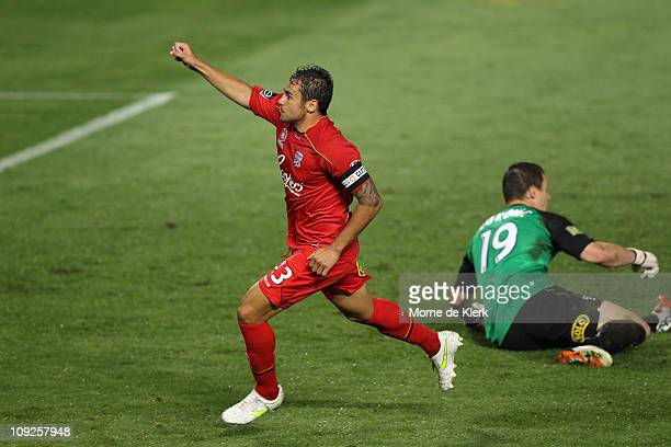 Travis Dodd of Adelaide celebrates after scoring a goal past Danny Vukovic of the Phoenix during the ALeague First Elimination Final match between...