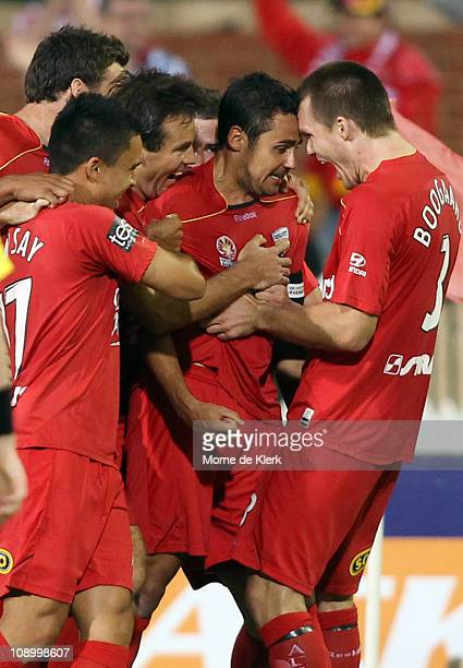 Travis Dodd of Adelaide celebrates with team mates after scoring a goal during the round 27 A-League match between Adelaide United and the Melbourne...