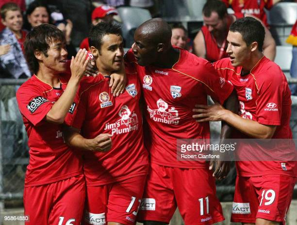 Travis Dodd of Adelaide United celebrates his goal with Inseob Shin Lloyd Owusu and Matthew Leckie during the round 19 ALeague match between Adelaide...