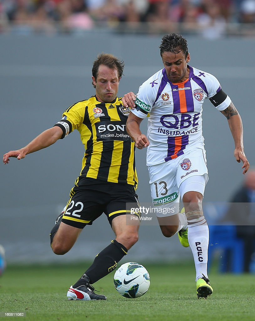 Travis Dodd of Perth (R) is tackled by Andrew Durante of the Phoenix during the round 19 A-League match between the Wellington Phoenix and the Perth Glory at Eden Park on February 2, 2013 in Auckland, New Zealand.