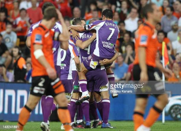 Travis Dodd of the Glory celebrates with team mates after scoring a goal during the 2012 ALeague Grand Final match between the Brisbane Roar and the...