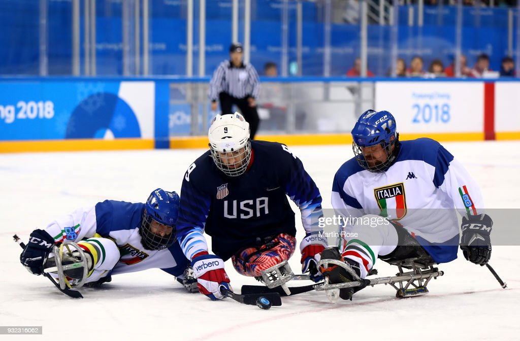 Travis Dodson #9 of United States battles for the puck with Eusebiu Antochi (L) and Roberto Radice of Italy in the Ice Hockey semi final game between United States and Italy during day six of the PyeongChang 2018 Paralympic Games on March 15, 2018 in Gangneung, South Korea.