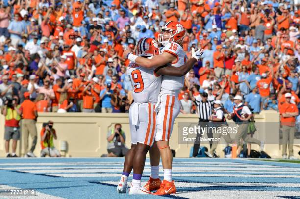Travis Etienne and Trevor Lawrence of the Clemson Tigers celebrate after a touchdown during the second quarter of their game against the North...