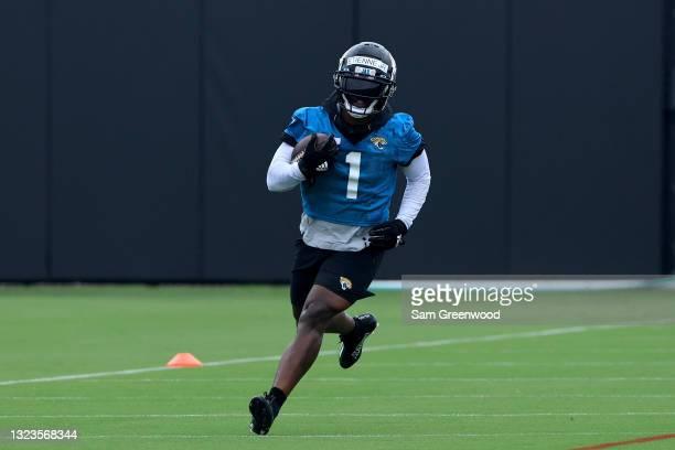 Travis Etienne Jr. #1 of the Jacksonville Jaguars participates in drills during Jacksonville Jaguars Mandatory Minicamp at TIAA Bank Field on June...