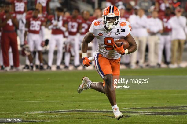 Travis Etienne of the Clemson Tigers carries the ball against the Alabama Crimson Tide in the CFP National Championship presented by ATT at Levi's...