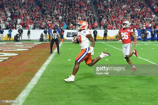Travis Etienne of the Clemson Tigers carries the ball into the end zone for a 53-yard touchdown reception against the Ohio State Buckeyes in the...