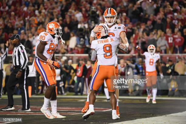 Travis Etienne of the Clemson Tigers celebrates his second quarter touchdown with Trevor Lawrence against thw Alabama Crimson Tide in the CFP...
