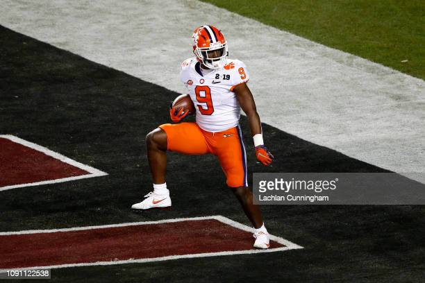 Travis Etienne of the Clemson Tigers celebrates his second quarter touchdown against the Alabama Crimson Tide in the College Football Playoff...