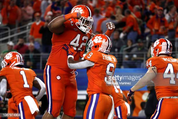 Travis Etienne of the Clemson Tigers celebrates with Christian Wilkins after a 62 yard touchdown run in the third quarter against the Notre Dame...