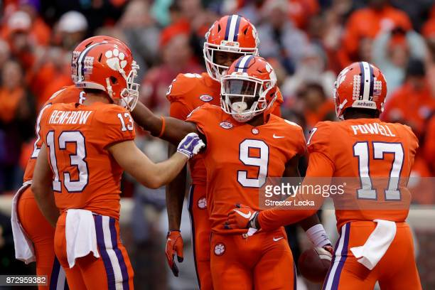 Travis Etienne of the Clemson Tigers celebrates with teammates after a touchdown against the Florida State Seminoles during their game at Memorial...