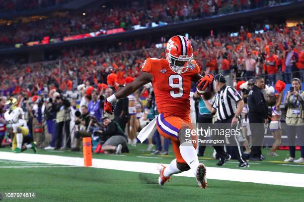 Travis Etienne of the Clemson Tigers runs for a 62 yard touchdown in the third quarter against the Notre Dame Fighting Irish during the College...