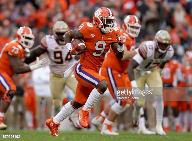Travis Etienne of the Clemson Tigers runs for a touchdown against the Florida State Seminoles during their game at Memorial Stadium on November 11...