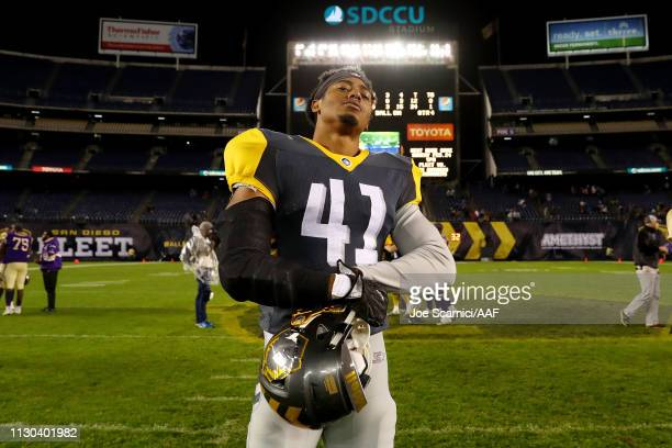 Travis Feeney of the San Diego Fleet poses for photos after beating the Atlanta Legends 2412 during the Alliance of American Football game at SDCCU...