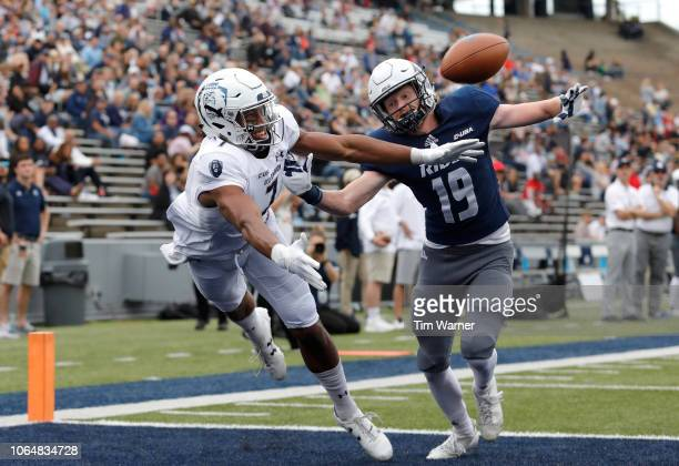 Travis Fulgham of the Old Dominion Monarchs attemts to make a reception in the end zone defended by Andrew Bird of the Rice Owls in the first half at...