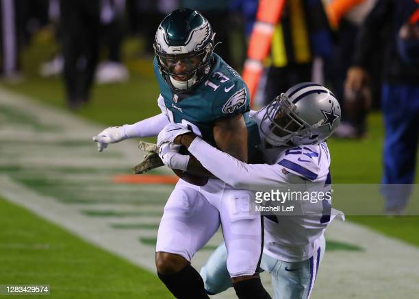 Travis Fulgham of the Philadelphia Eagles makes a first down reception while being tackled by Trevon Diggs of the Dallas Cowboys in the first quarter...
