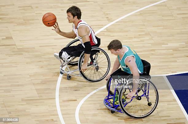 Travis Gaertner of Canada takes off on a fast break against Shaun Norris of Australia during their gold medal wheelchair basketball game on September...