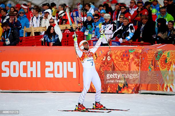 Travis Ganong of the United States jubilates during the Alpine Men's Downhill on day two of the Sochi 2014 Winter Olympics at Rosa Khutor Alpine...