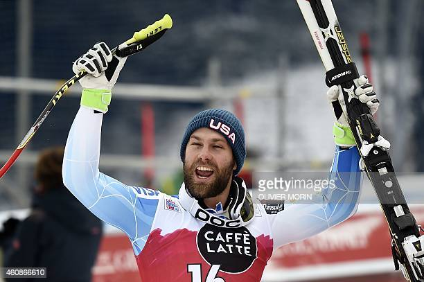 Travis Ganong of the US celebrates after competing in the Men's FIS Ski World Cup downhill race in Santa Caterina Italy on December 28 2014 Ganong...