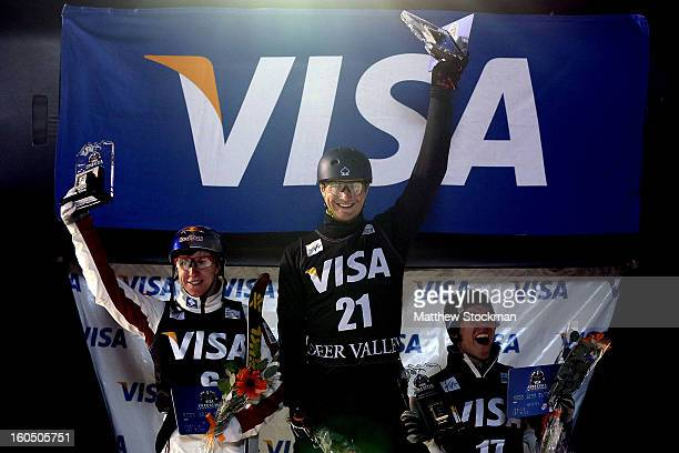 Travis Gerrits of Canada in second place, Maxim Gustik of Belarus in first place and Michael Rossi in third place stand on the medals podium after...