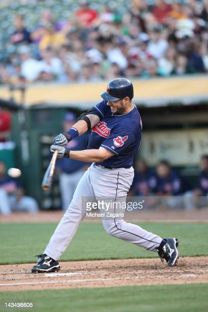 Travis Hafner of the Cleveland Indians bats during the game against the Oakland Athletics at the OaklandAlameda County Coliseum on April 21 2012 in...