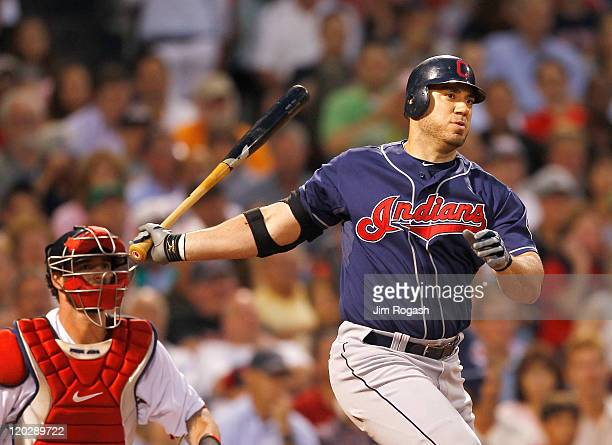 Travis Hafner of the Cleveland Indians knocks in a run with a double against the Boston Red Sox at Fenway Park on August 3 2011 in Boston...