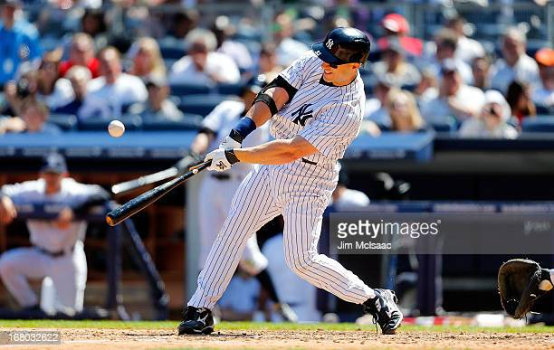 Travis Hafner of the New York Yankees connects on a sixth inning broken bat RBI single against the Oakland Athletics at Yankee Stadium on May 4 2013...