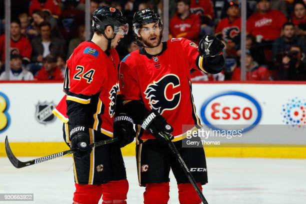 Travis Hamonic and Michael Frolik of the Calgary Flames have a discussion during an NHL game against the New York Islanders on March 11 2018 at the...