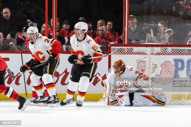 Travis Hamonic Matthew Tkachuk and David Rittich of the Calgary Flames defend against Matt Duchene of the Ottawa Senators at Canadian Tire Centre on...