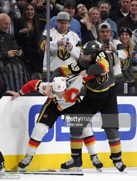 Travis Hamonic of the Calgary Flames and Alex Tuch of the Vegas Golden Knights fight in the third period of their game at TMobile Arena on February...