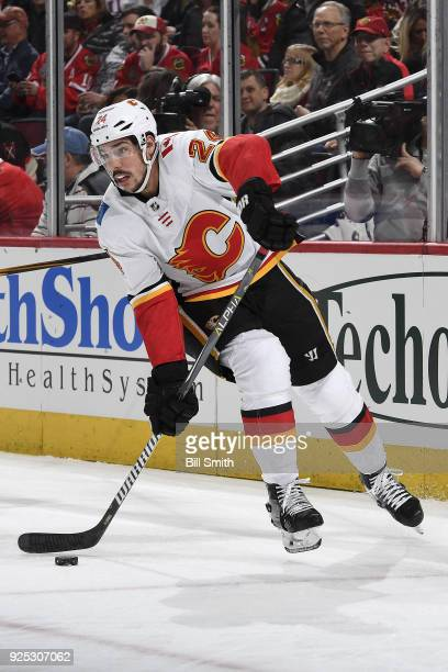 Travis Hamonic of the Calgary Flames approaches the puck in the first period against the Chicago Blackhawks at the United Center on February 6 2018...