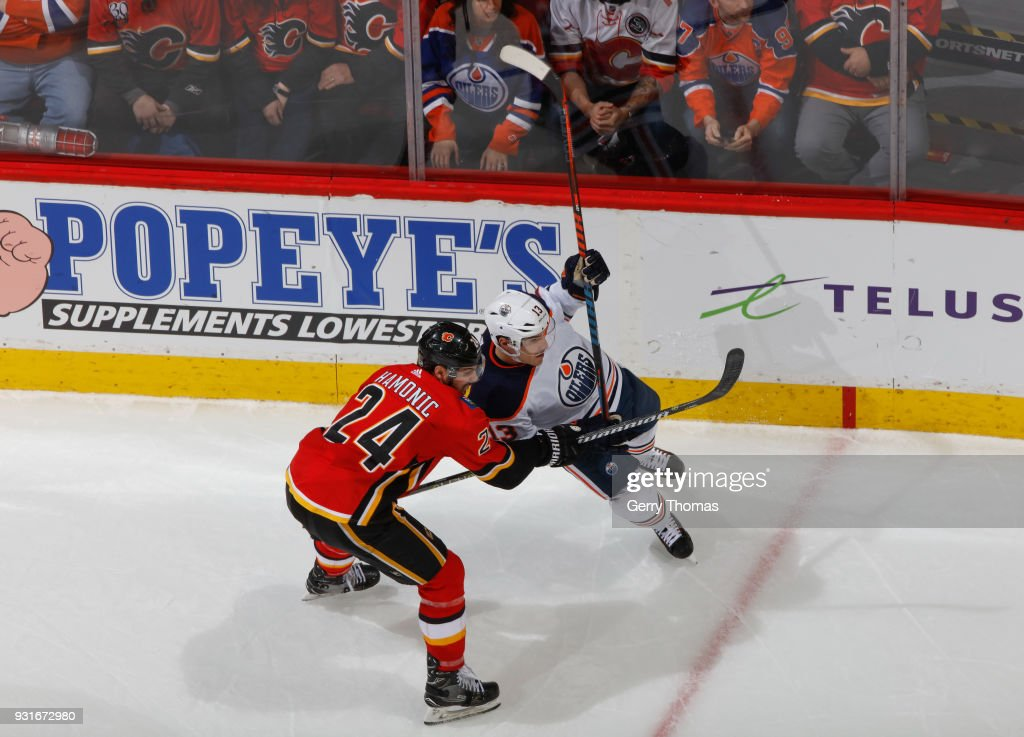 Travis Hamonic #24 of the Calgary Flames battles against the Edmonton Oilers at Scotiabank Saddledome on March 13, 2018 in Calgary, Alberta, Canada.