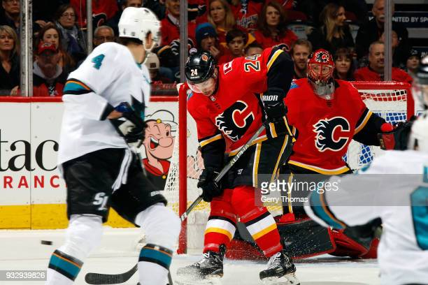 Travis Hamonic of the Calgary Flames blocks a shot against the San Jose Sharks during an NHL game on March 16 2018 at the Scotiabank Saddledome in...