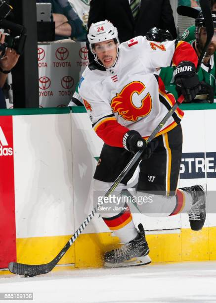 Travis Hamonic of the Calgary Flames handles the puck against the Dallas Stars at the American Airlines Center on November 24 2017 in Dallas Texas