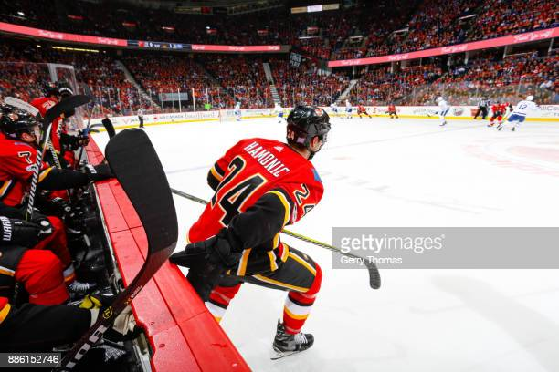 Travis Hamonic of the Calgary Flames jumps to the ice in an NHL game against the Toronto Maple Leafs at the Scotiabank Saddledome on November 28 2017...