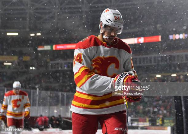 Travis Hamonic of the Calgary Flames leaves the ice at the end of the first period against the Winnipeg Jets during the 2019 Tim Hortons NHL Heritage...