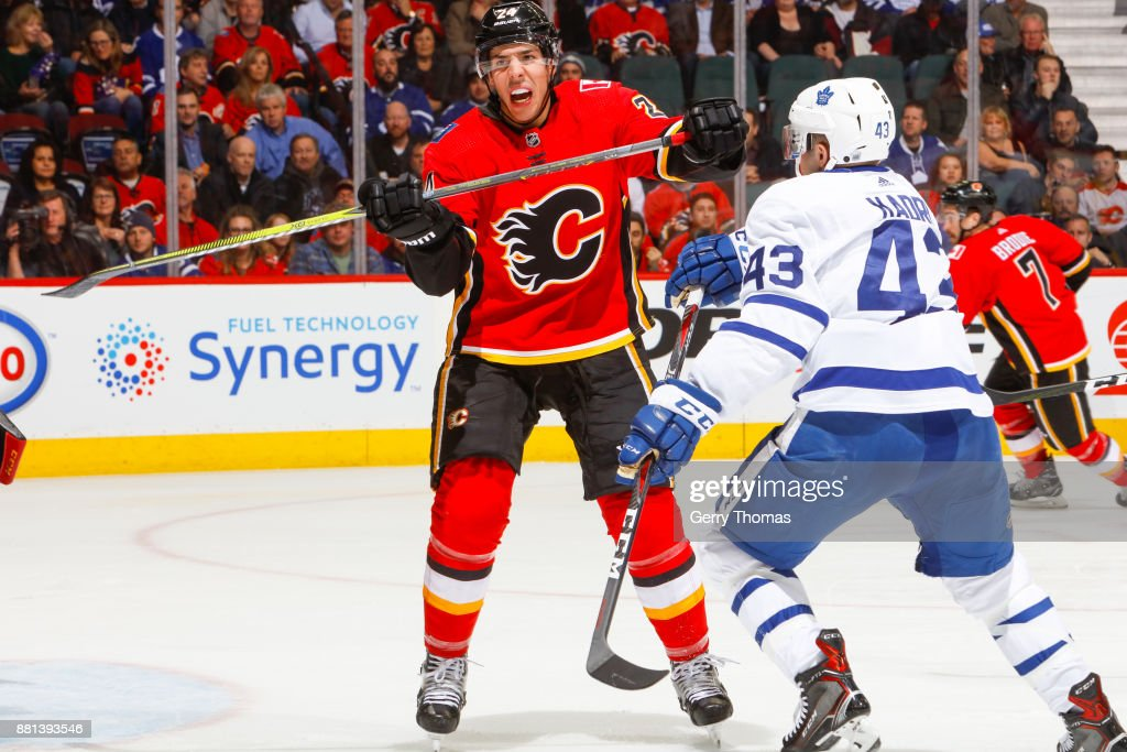 Travis Hamonic #24 of the Calgary Flames looks for a pass in an NHL game against the Toronto Maple Leafs at the Scotiabank Saddledome on November 28, 2017 in Calgary, Alberta, Canada.