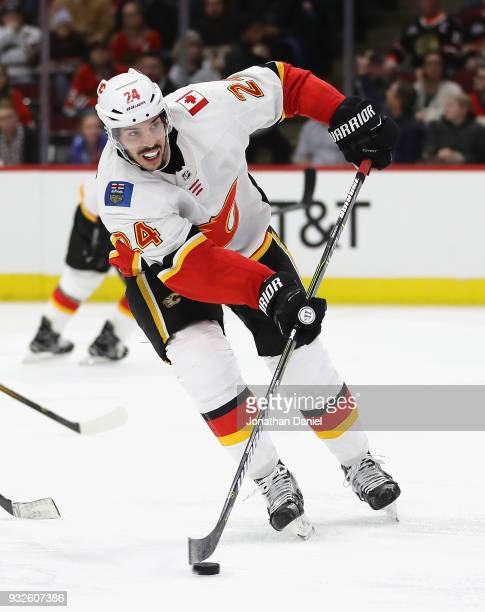 Travis Hamonic of the Calgary Flames passes against the Chicago Blackhawks at the United Center on February 6 2018 in Chicago Illinois The Flames...