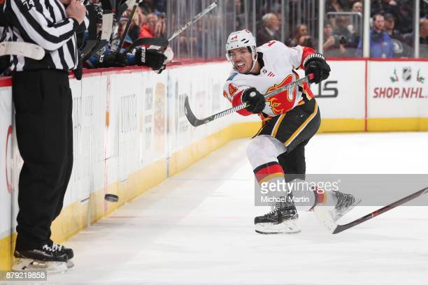 Travis Hamonic of the Calgary Flames passes the puck into the zone against the Colorado Avalanche at the Pepsi Center on November 25 2017 in Denver...